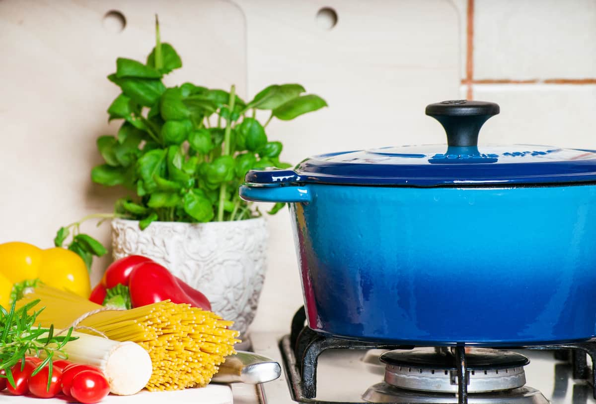 Blue cast iron pot cooking on the stove