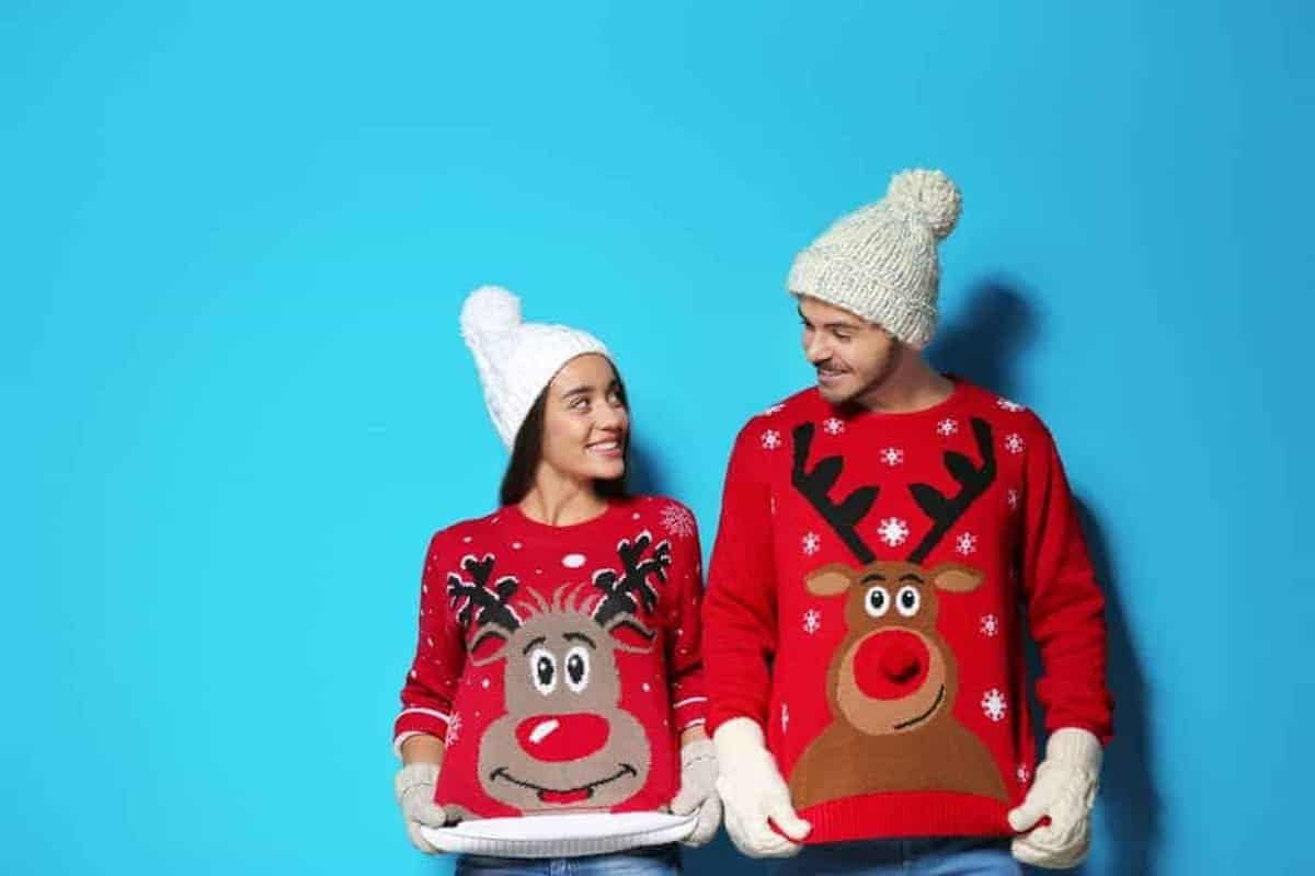 fun couple with ugly reindeer sweaters