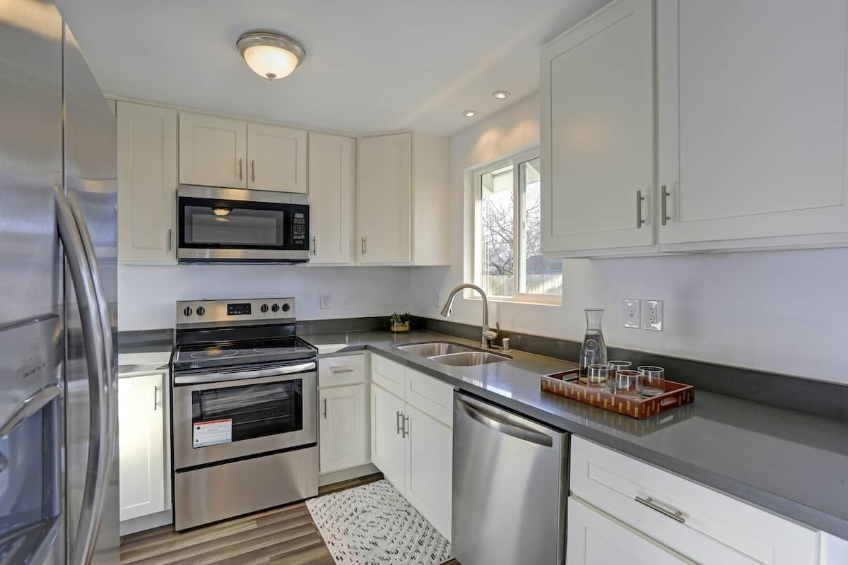 Compact kitchen in an apartment with upgraded appliances and countertops