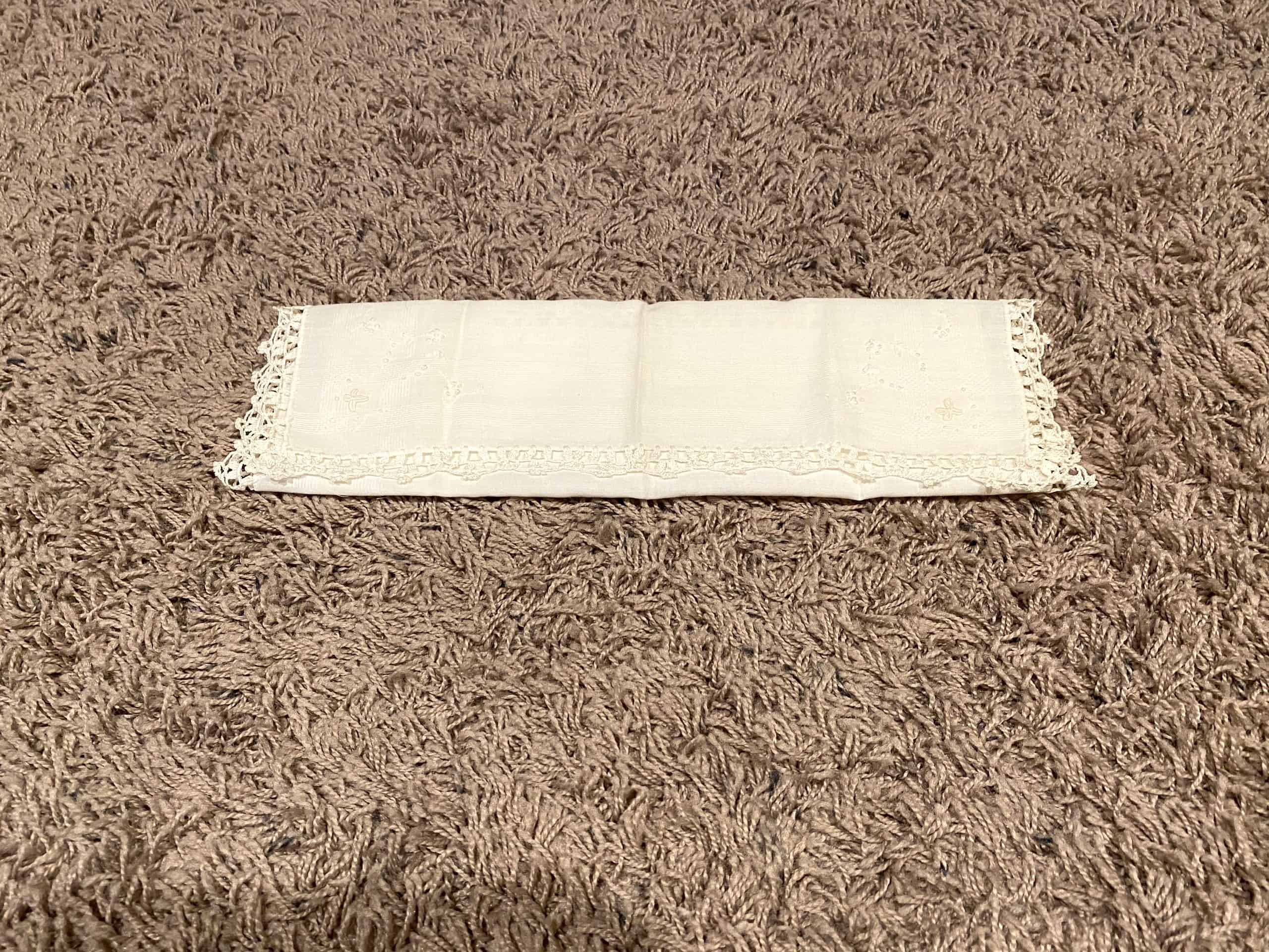 Handkerchief and paper towel used to make your own face mask.