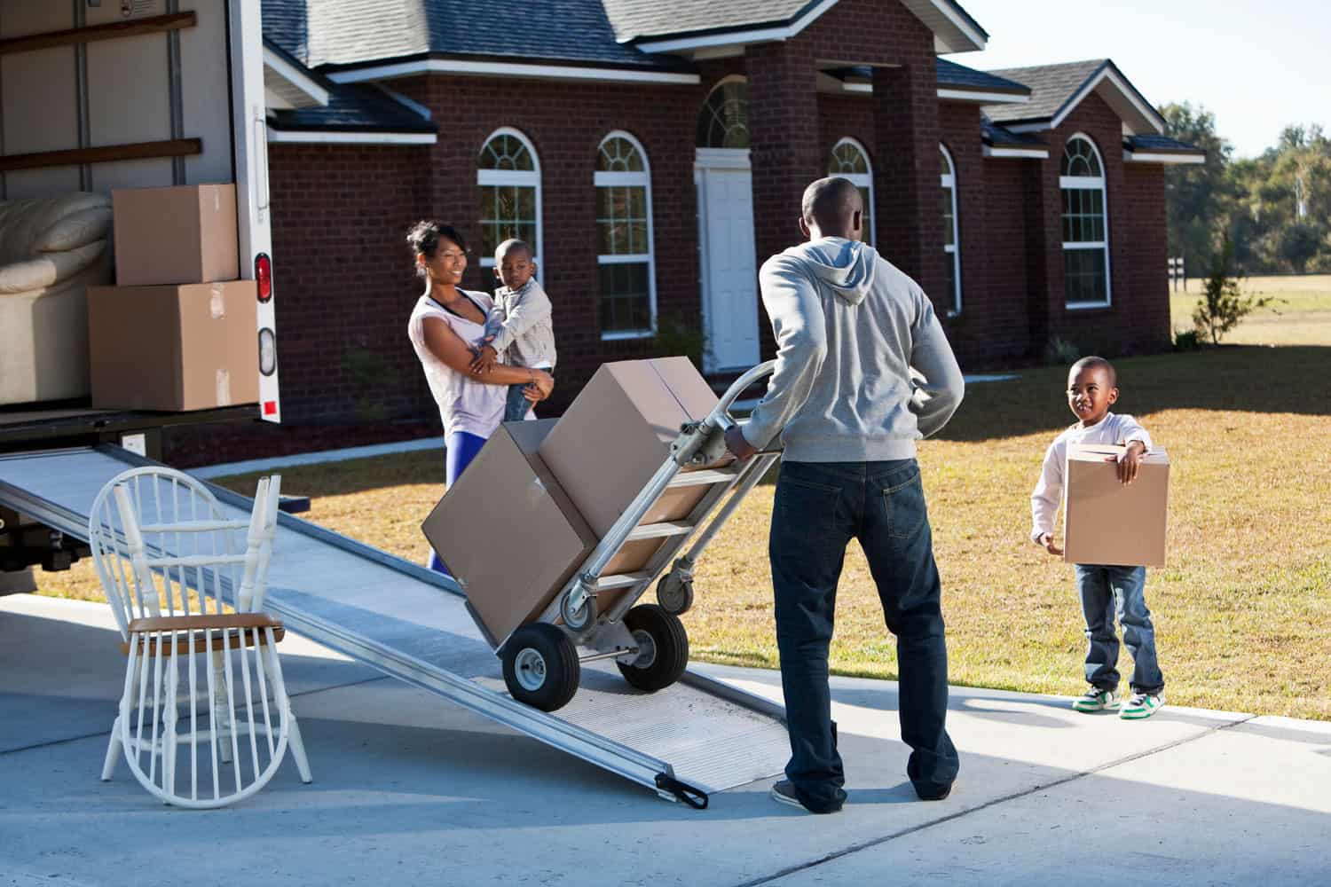 family unpacking a moving truck
