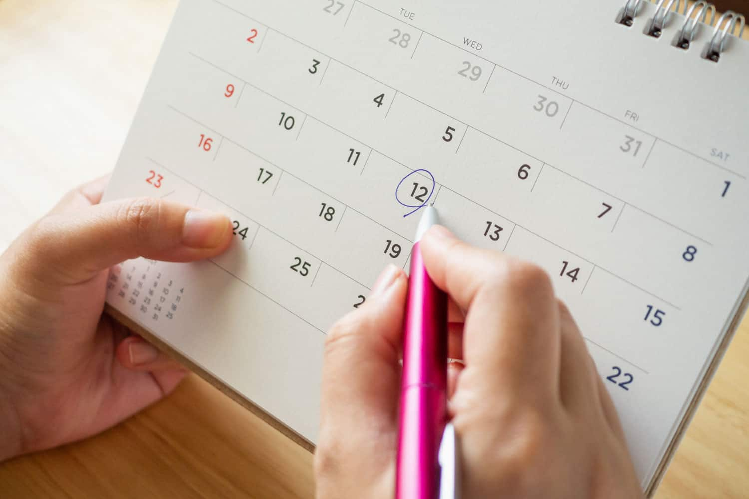 photo of person putting their lease end date in the calendar