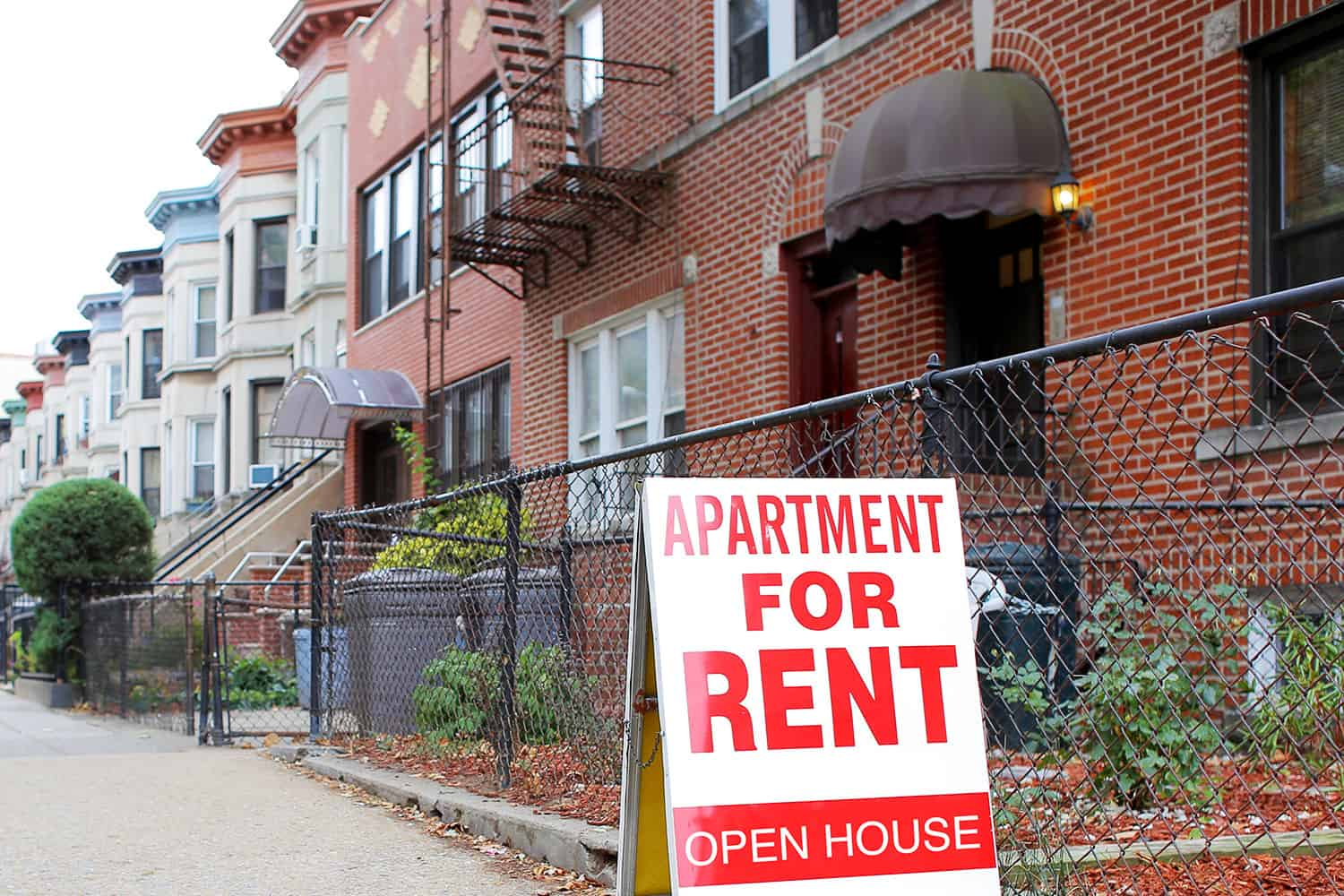 photo of an apartment for rent sign