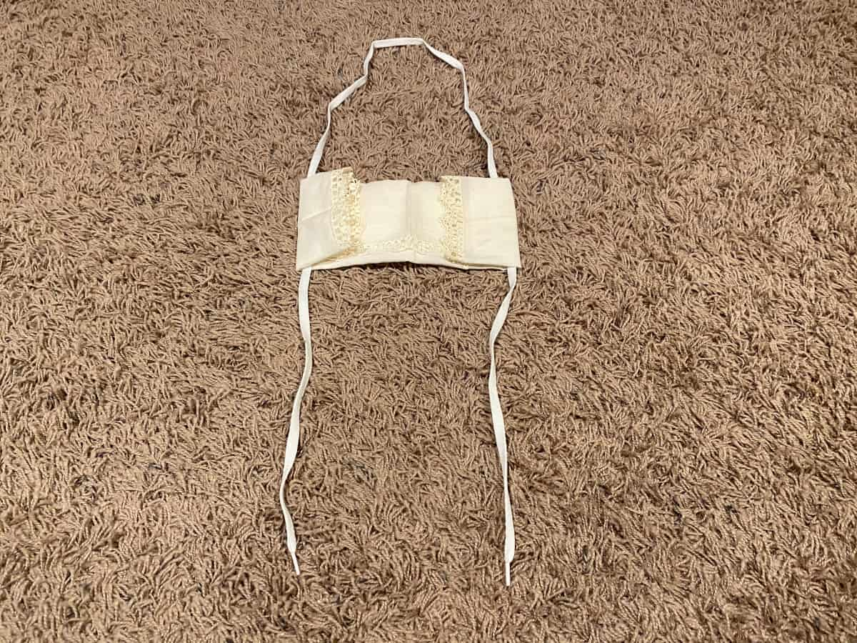 Handkerchief, paper towel and string used to make your own face mask.