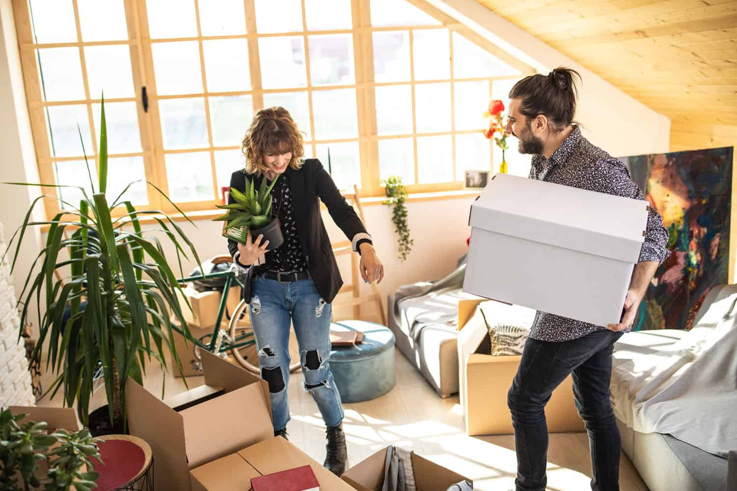 photo of couple unpacking in their new apartment
