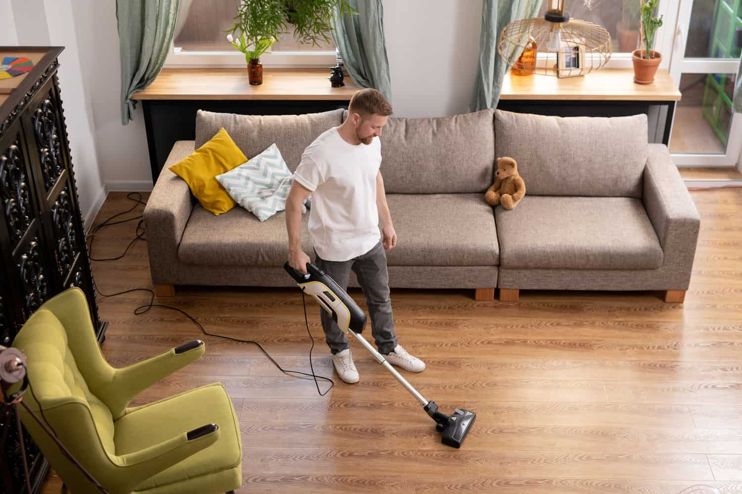 man cleaning his apartment