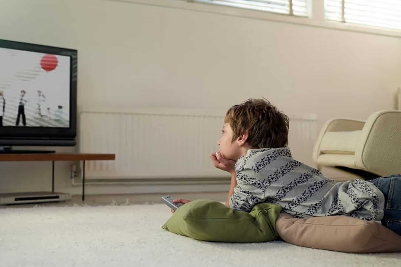 boy watching a tv