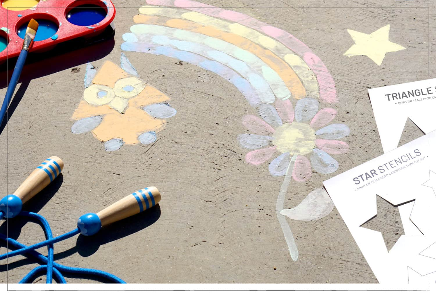 chalk paint on sidewalk of a rainbow and owl