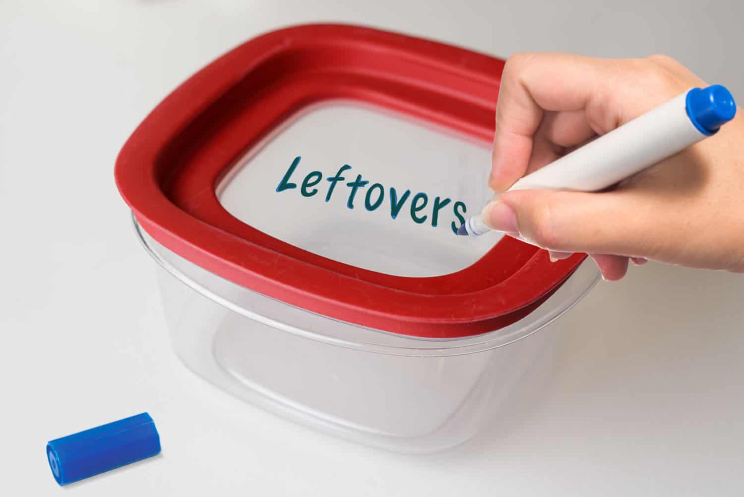 writing leftovers on plastic container with permanent marker
