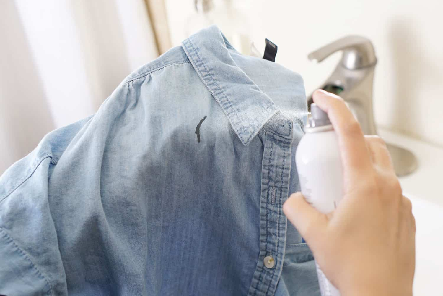 using hairspray to remove a stain from a shirt