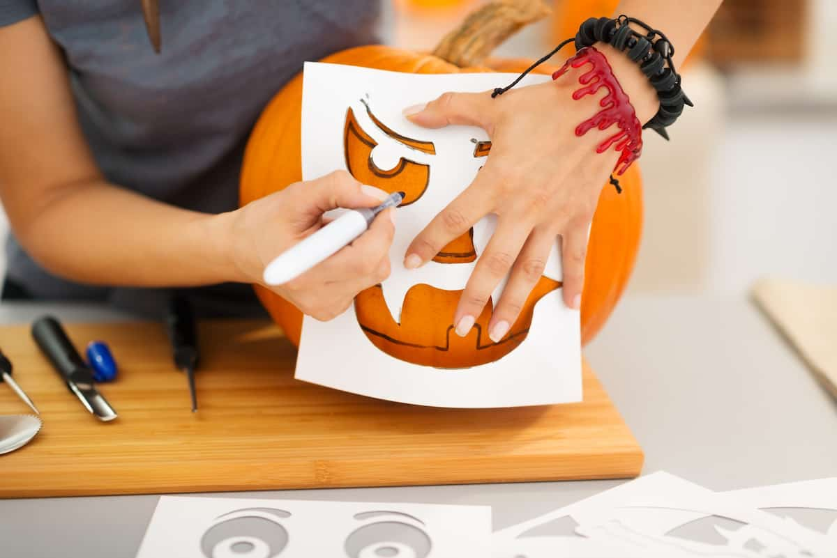 carving pumpkin with stencil