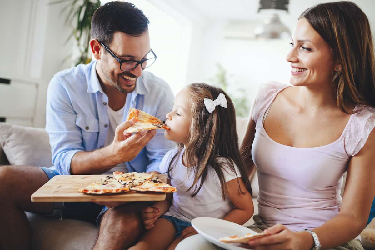 family eating food social distancing