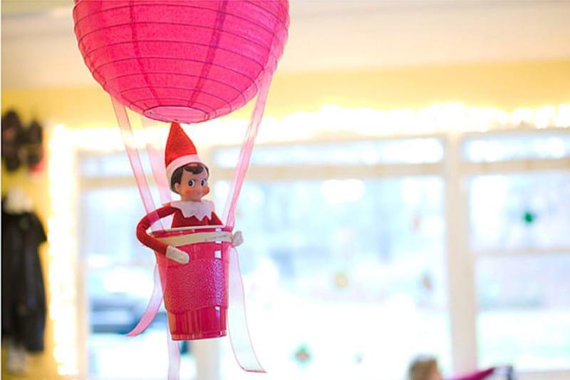 Elf taking a hot air balloon ride
