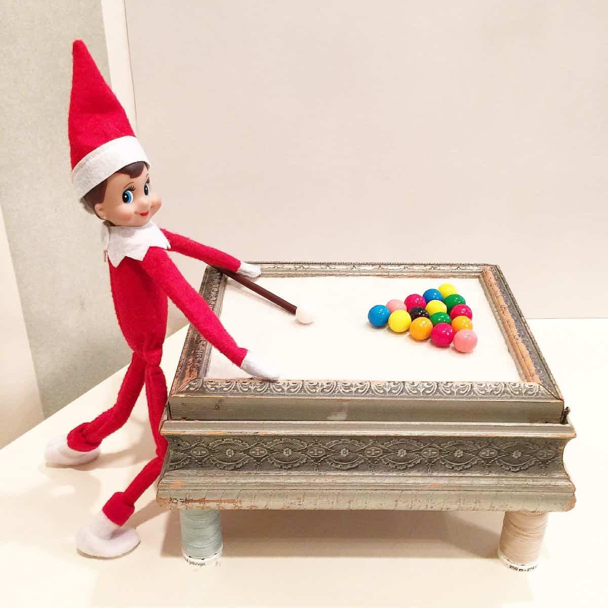 Elf playing pool