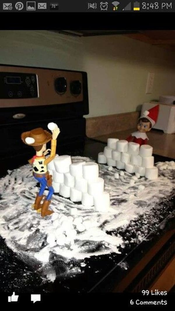 Elf and Woody having a snowball fight