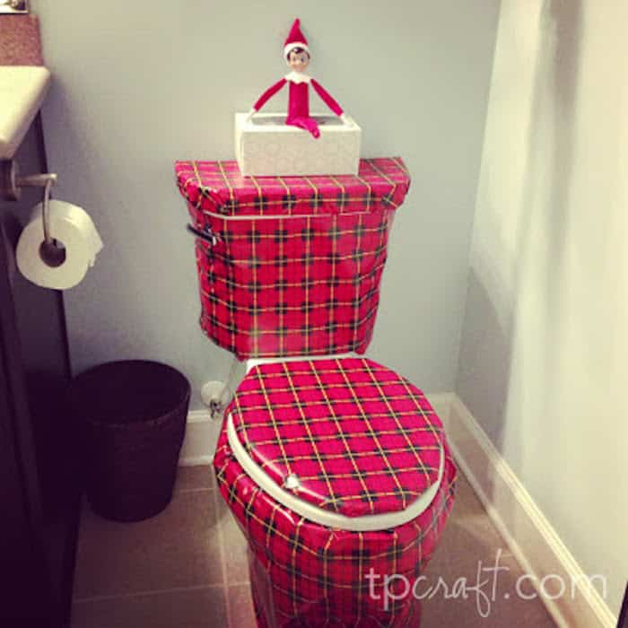 Elf wrapping a toilet