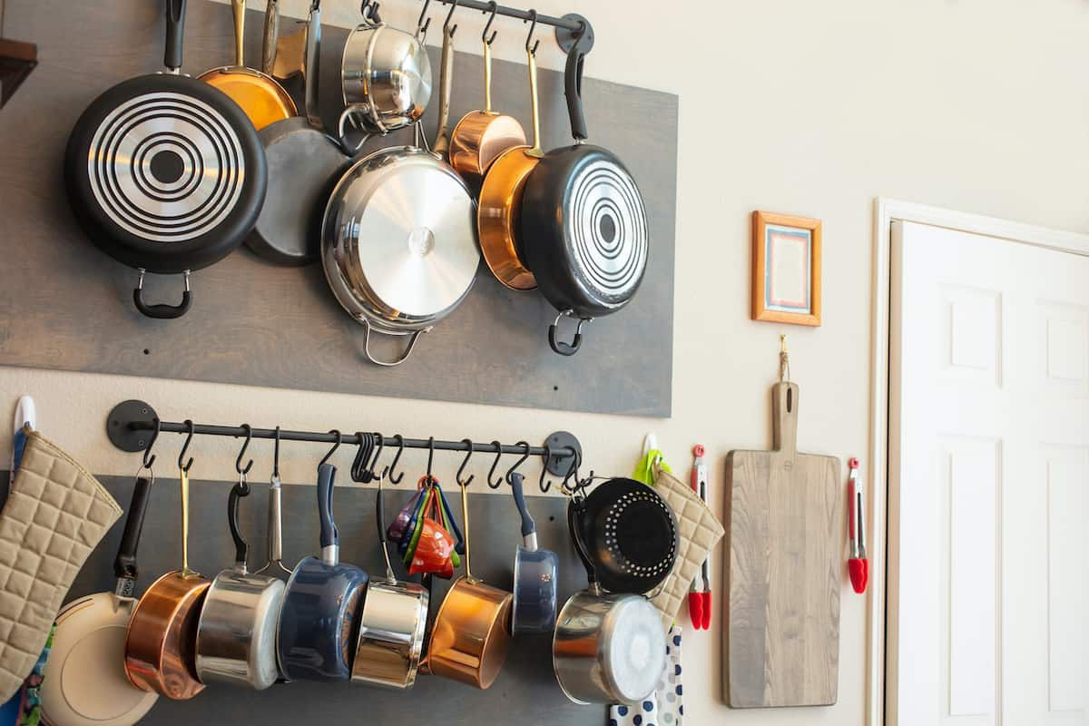 pots and pans on wall