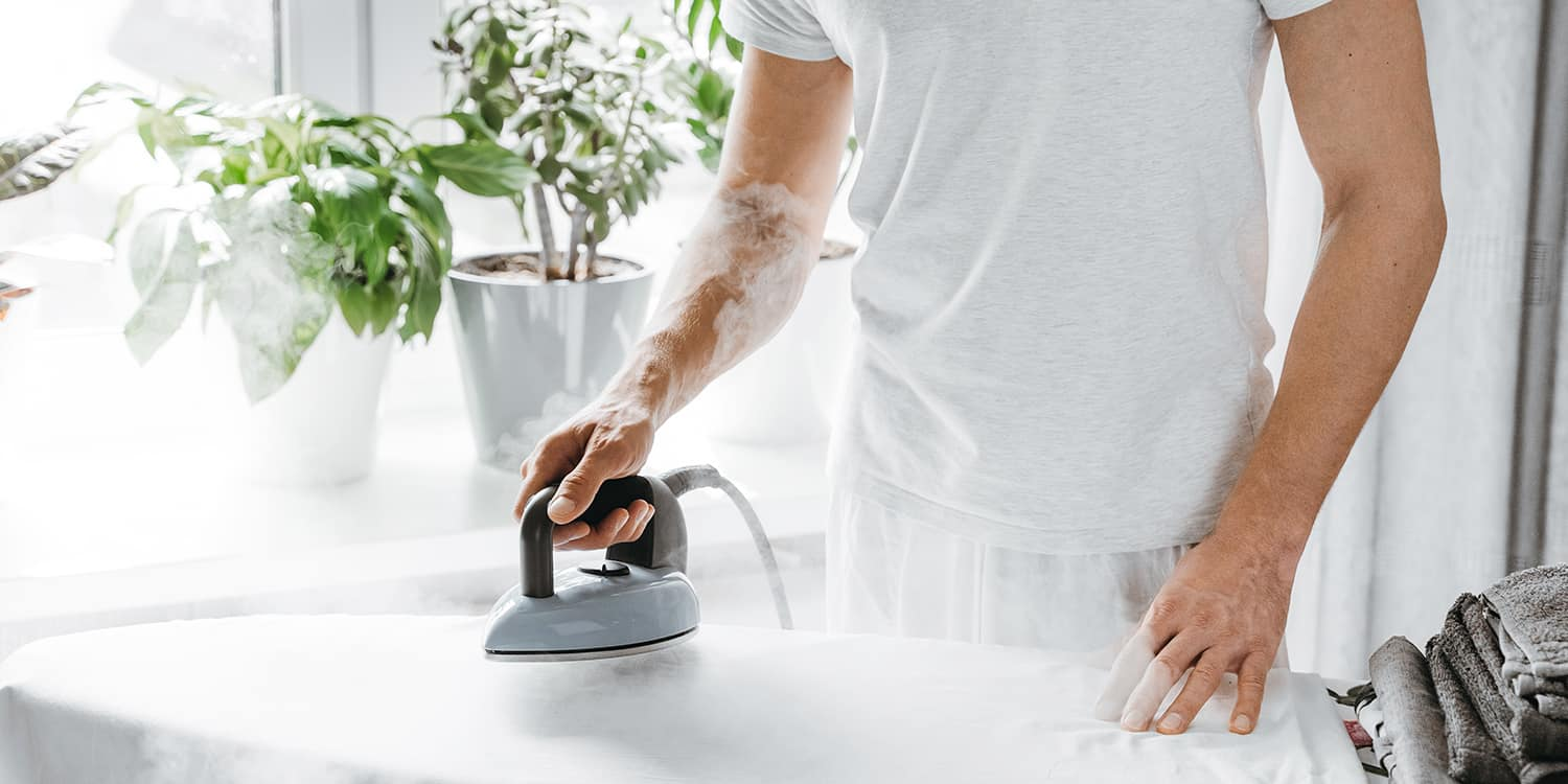 person steaming their iron