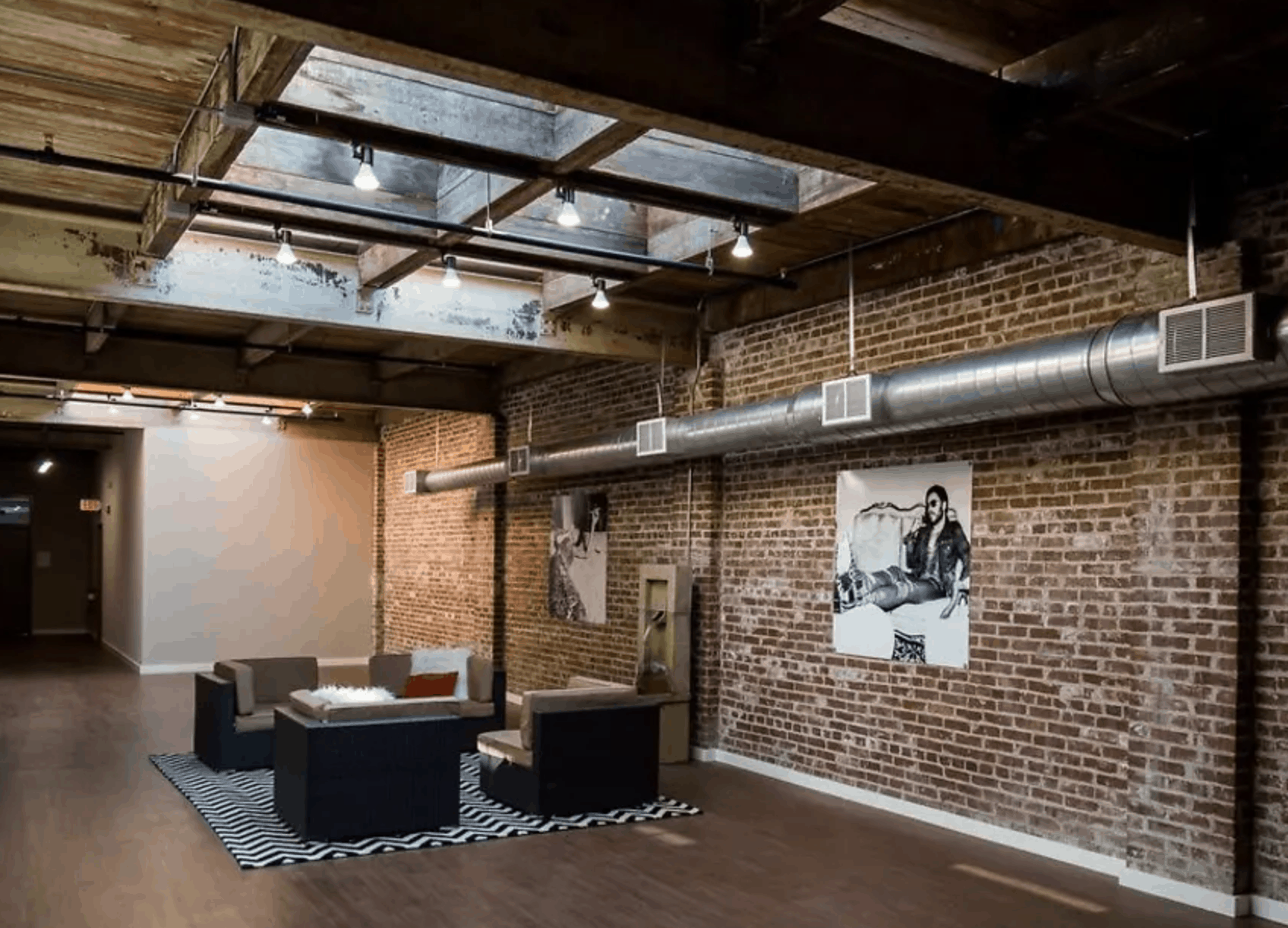 loft apartment with exposed brick and light fixtures, large open space