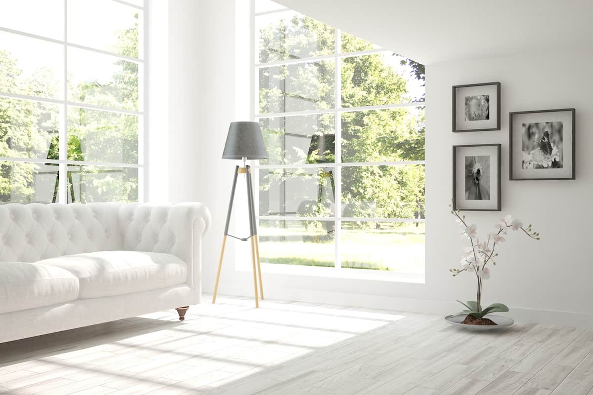 Bright white room with a white couch, light white flooring and big windows small living room ideas