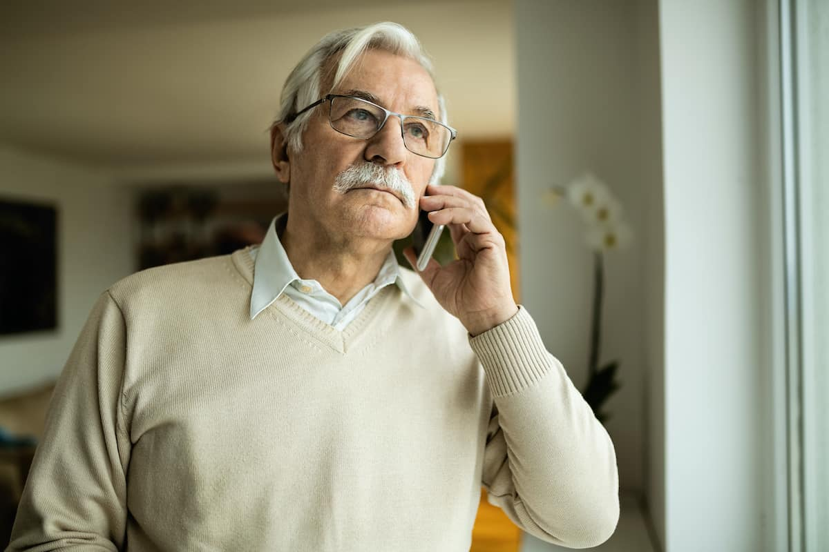 man on the phone talking about bad smells in the home