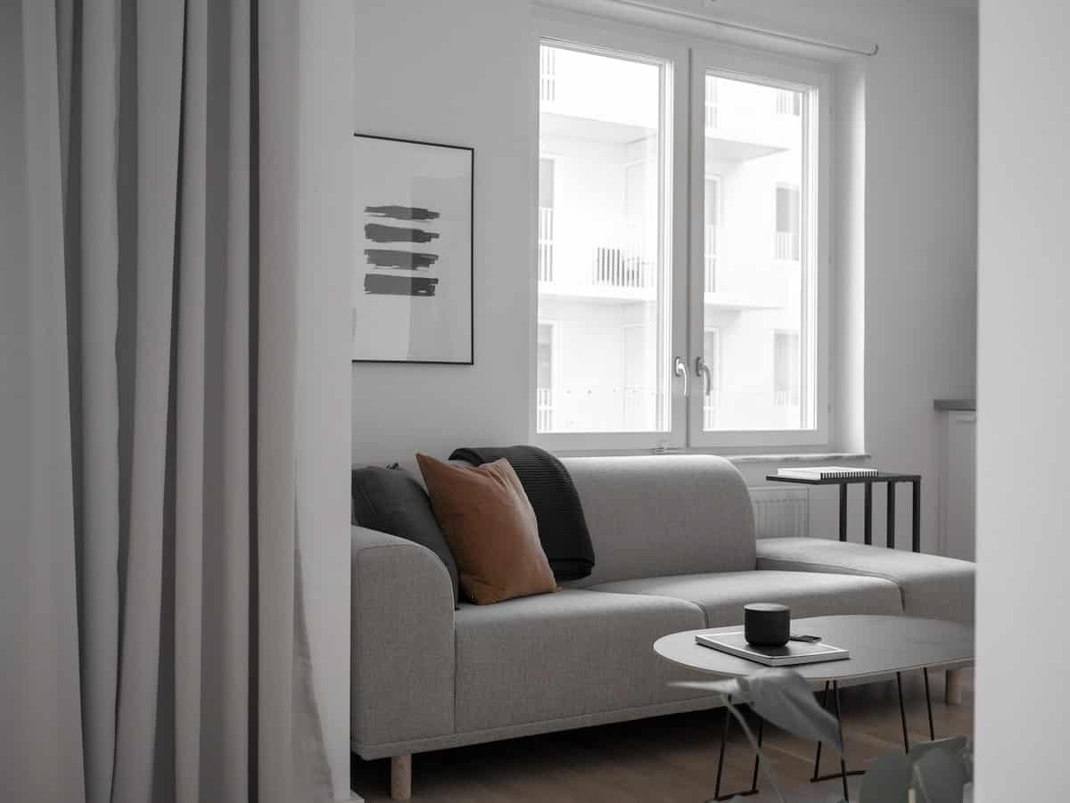 A couch in an apartment.