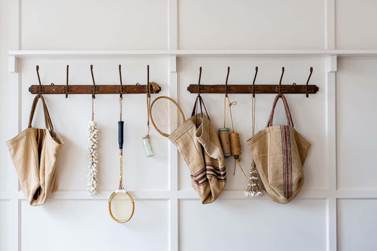 Horizontal coat rack holding a multitude of things to be used for shoe storage in small space