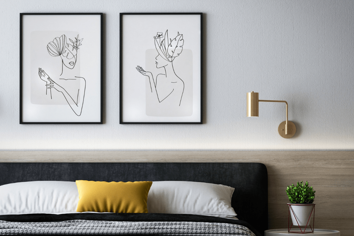 Minimalistic bedroom design with art on the walls.