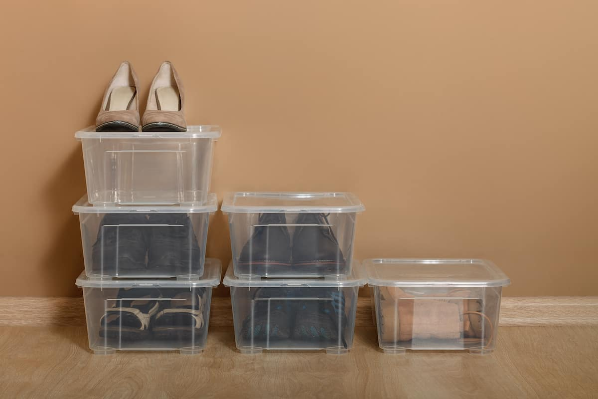 Plastic bins used for shoe storage in small space