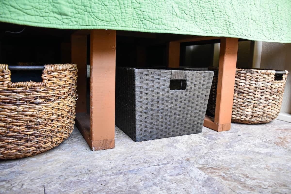 Baskets hidden underneath a bed.