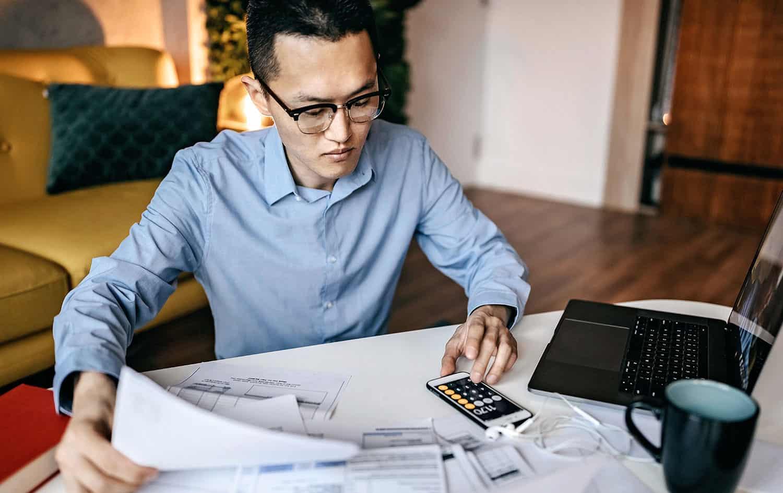 Man calculating rent and bills